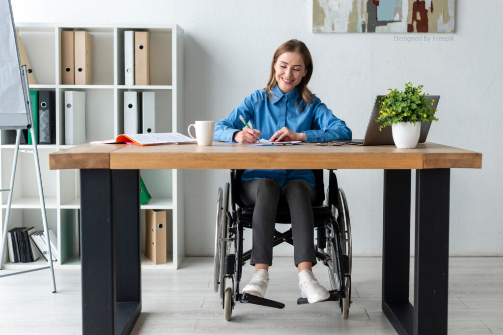 image of lady in wheelchair working at desk