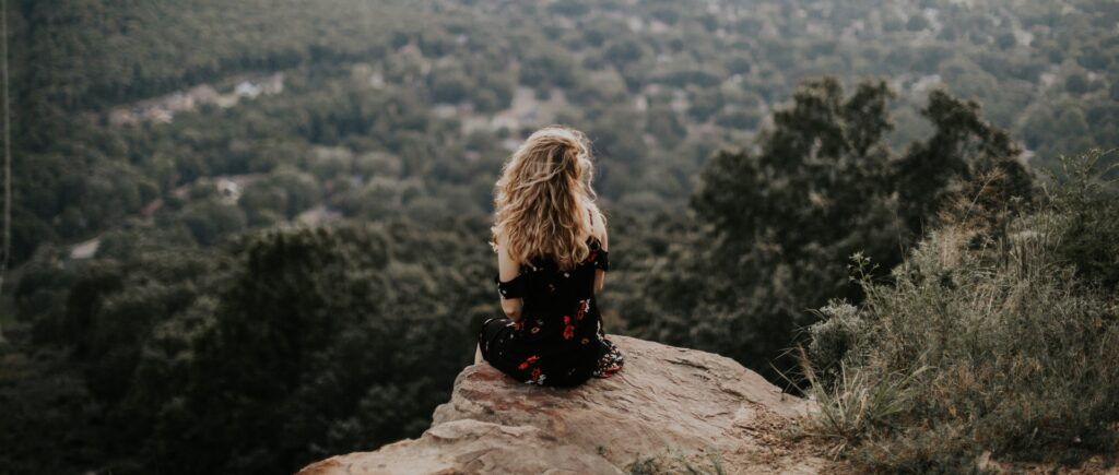 image of girl looking over valley